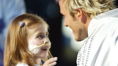 Kirsty Howard was joined by Manchester United and England footballer David Beckham to hand over the Jubilee Baton to the Queen at the Opening Ceremony of the 2002 Commonwealth Games in Manchester ©Getty Images