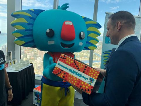 CGF CEO David Grevemberg receives a Borobi Language Kit from the Gold Coast 2018 mascot